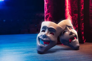 Theater masks, drama and comedy with a red curtain as backdrop / 3D Rendering, Mixed media.